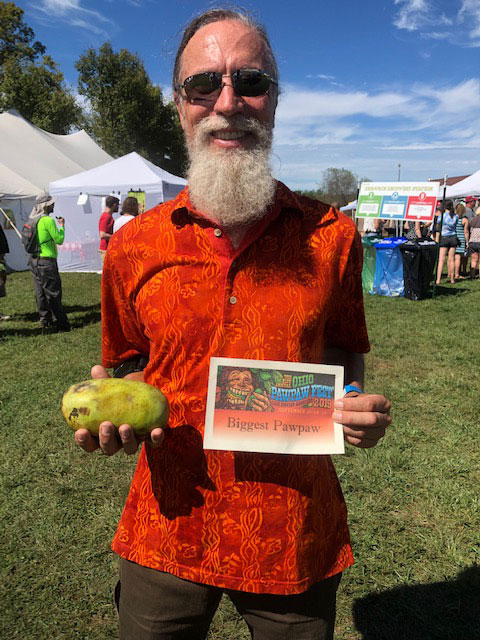 Richard Owens holding the 2019 Biggest Pawpaw